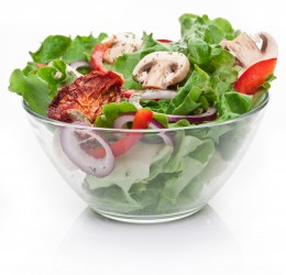 Salad with dried tomatoes, champignon and onion.